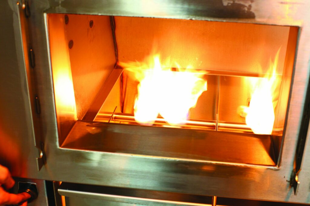 interior of Champion TUFF gas/wood-burning grill
